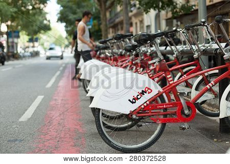 Barcelona, Spain - September 23, 2018: Public Bicycle Service In The Street Of Barcelona