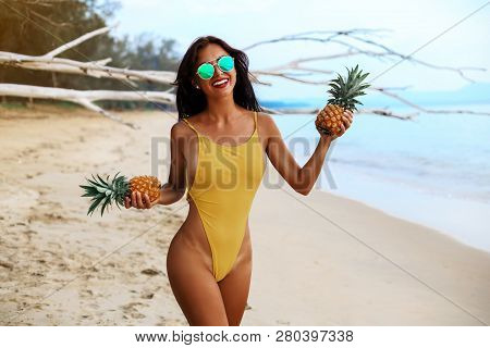 Incredibly Beautiful Sexy Girl Models In A Bikini On The Sea Shore Of A Tropical Island Pineapple, B