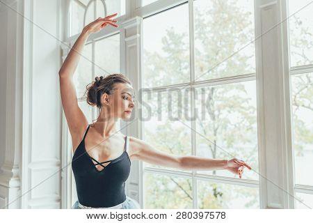 Young Classical Ballet Dancer Woman In Dance Class. Beautiful Graceful Ballerina Practice Ballet Pos