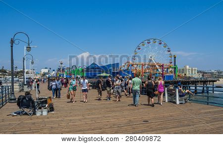 Santa Monica, Ca - May 18, 2018: Tourists In Santa Monica Pier On A Beautiful Day. The Pier Contains