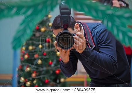 Paparazzi Man Taking Picture With Photo Camera . Close Up Of Azerbaijan Man Holding A Photo Camera A