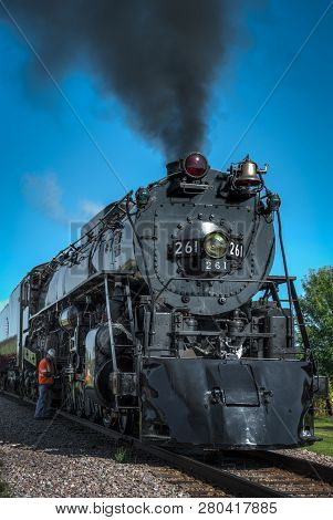 Bongards, Mn - September 8, 2018: Crew Member Makes Final Checks On The Steam Engine Milwaukee Road