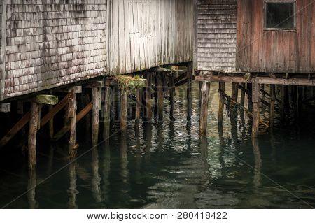 Pilings At Base Of Wharf Buildings - Horizontal - New Harbor, Maine, Usa