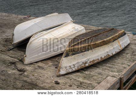 Overturned Rowboats On Dock - New Harbor, Maine, Usa