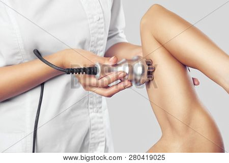 The Doctor Does The Rf Lifting Procedure On The Upper Arm Of A Woman In A Beauty Parlor. Treatment O