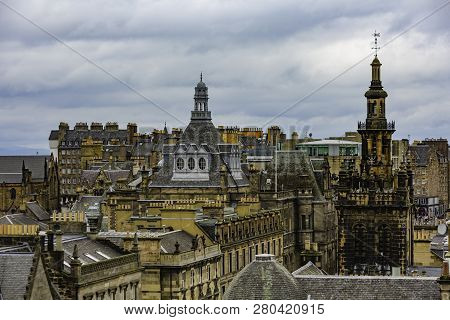 Rooftops In Edinburgh Scotland Under A Grey And Cloudy Sky