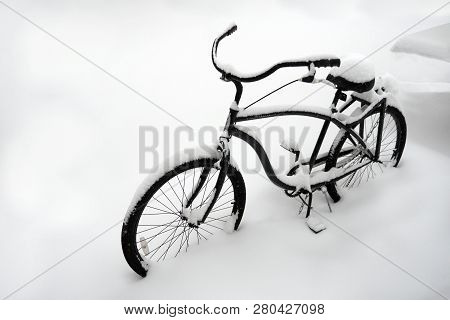 Kyiv, Ukraine - Circa January 2019: Bicycle Covered In Snow. Bicycle Parked In Snow. Bike Buried In