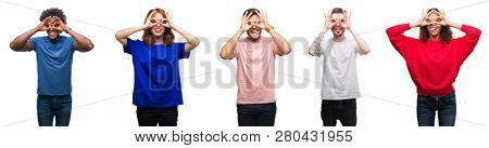 Composition of african american, hispanic and caucasian group of people over isolated white background doing ok gesture like binoculars sticking tongue out, eyes looking through fingers. Crazy