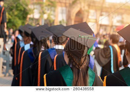 Graduates Wear Black Hats, Black Hats.graduates Join The Graduation Ceremony At The University.