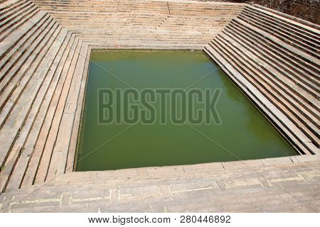 Cleanly maintained stepped pond at Melukote in Mandya District, Karnataka, India, Asia poster