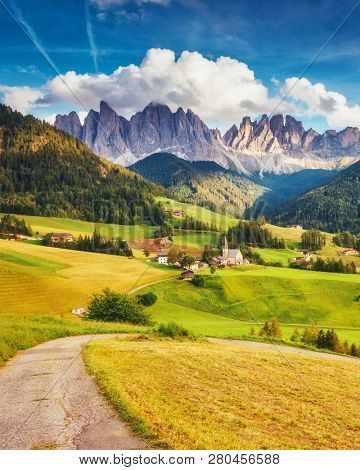 Countryside view of the Funes valley St. Magdalena or Santa Maddalena in the National park Puez Odle or Geisler. Dolomiti, South Tyrol. Location Bolzano, Italy, Europe. Dramatic scene. Beauty world.