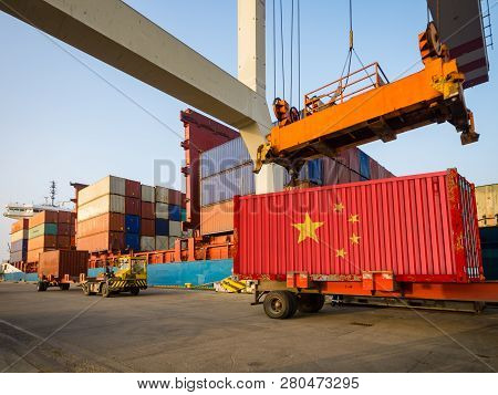 Chinese Container With The Flag Of The People's Republic Of China In The Port. The Concept Of Chines