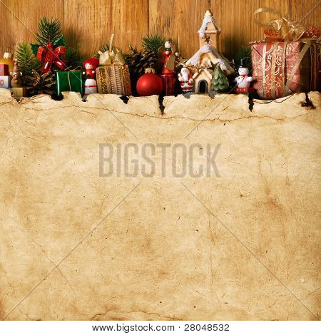 home made Christmas decoration and vintage paper on the wood background