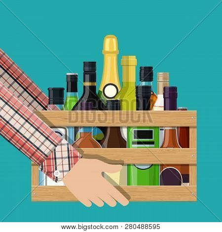 Alcohol Drinks Collection In Box In Hand. Bottles With Vodka Champagne Wine Whiskey Beer Brandy Tequ