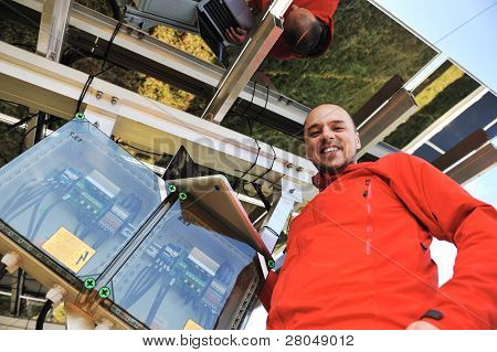 Engineer working with laptop installing  solar panels