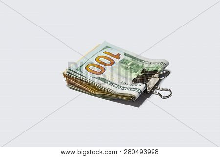 Dollar Notes Of Different Denominations With A Golden Clip, Isolated On A White Background.