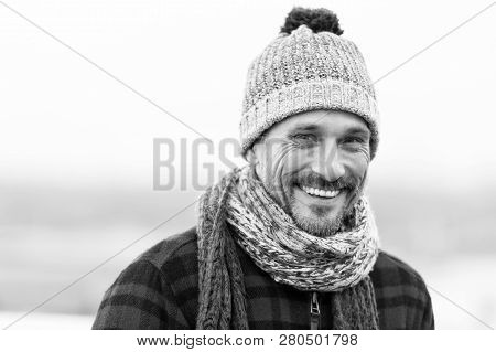 Portrait Of Urban Smiling Man. Happy Men In Knitted Hat And Scarf. Funny Man Smiles To Camera. Close