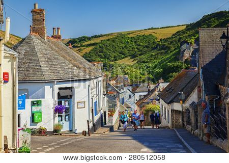 29 June 2018: Port Isaac, Cornwall, Uk - Group Of People Walking In Fore Street During The Summer He