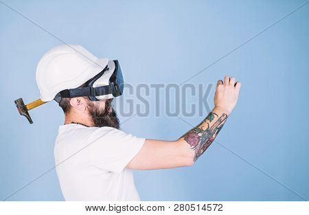 Builder And Renovation Concept. Hipster Busy With Renovation In Virtual Reality. Man With Beard In V