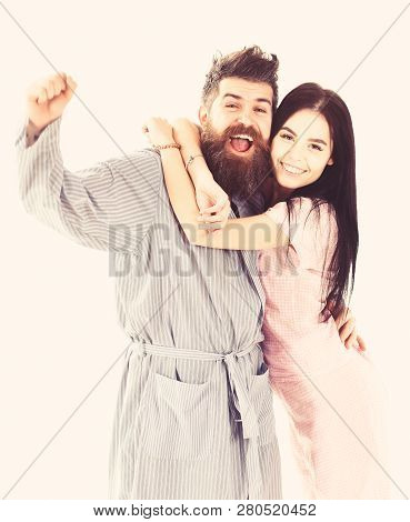 Couple In Love Hugging In Pajama, Bathrobe. Couple Cuddling, Isolated On White Background. Couple, F