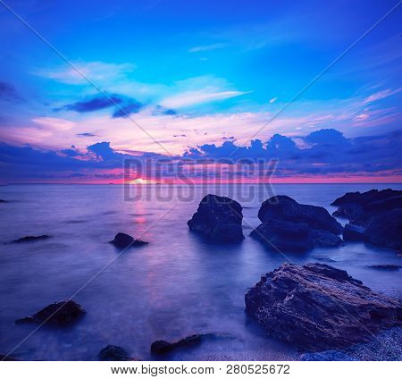 Beautiful Colorful Sunrise At The Sea With Dramatic Clouds And Boulders. Beauty World Natural Outdoo