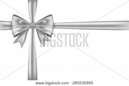 Silver Gift Bow Ribbon. Bow Tie Isolated On White Background. 3d Shiny Gift Bow Tie For Christmas Pr