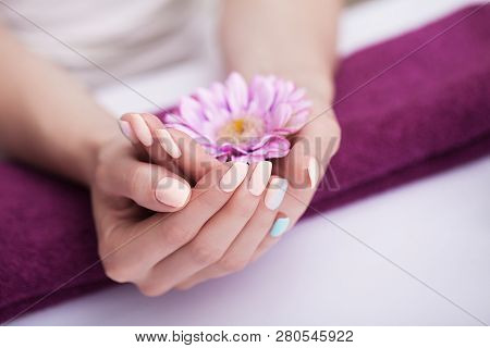 Nails In The Spa. Beautiful Manicure. Spa Treatments For Hands And Nails. Soaking The Hands In The H