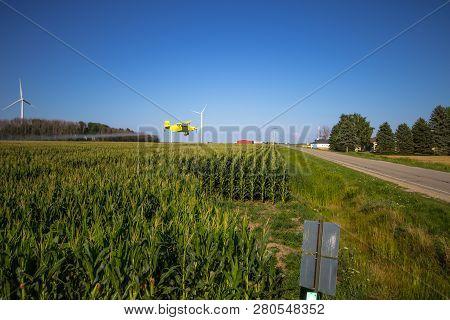 Sandusky, Michigan, Usa - August 1, 2016: Crop Duster Spraying A Corn Field On A Farm In The Heartla