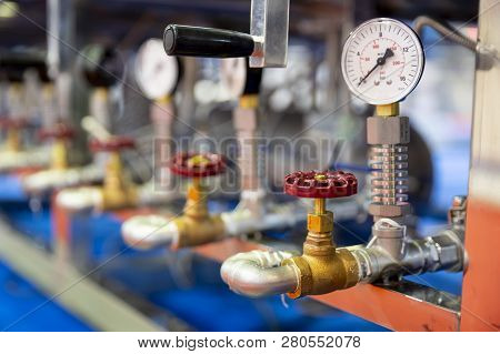 Pressure Measuring Instrument - Bar, Psi. Red Metal Valves On The Pipes. Pressure Device For Industr