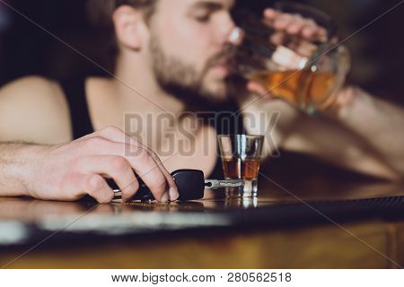 Stay Alive, Dont Drink And Drive. Handsome Man With Car Keys Drink Beer At Bar Counter. Man Drinker