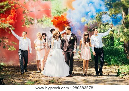 Russia, Orenburg-may 07, 2016: Wedding Guests. Bride And Groom Kissing At Wedding Ceremony. Funny Gu