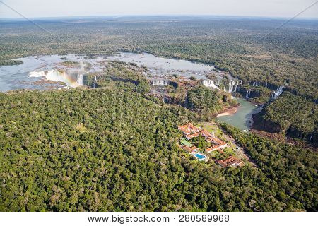 Aerial Bird's-eye View Panorama Of Iguazu Falls From Above, From A Helicopter. Border Of Brazil And