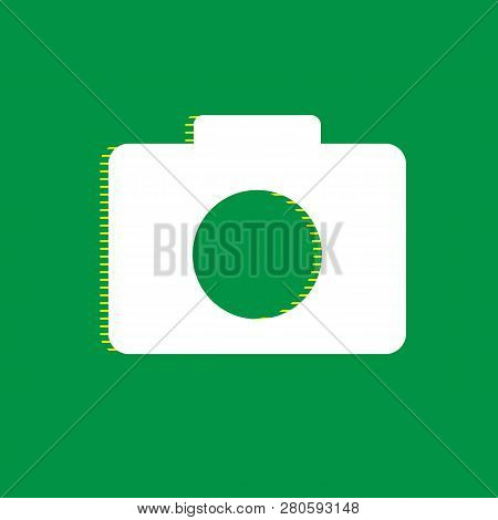 Digital Camera Sign. Vector. White Flat Icon With Yellow Striped Shadow At Green Background. Illustr