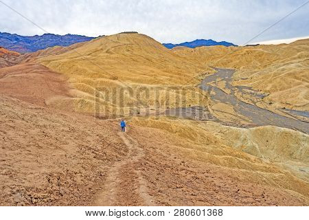 Hiking Into A Lonely Desert Valley In The Golden Valley Near Zabriskie Point In Death Valley Nationa