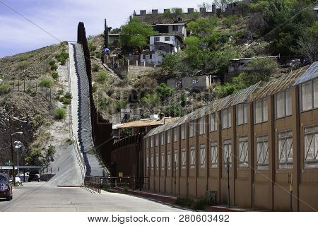 United States Border Wall With Nogales Mexico Neighborhood On The Right