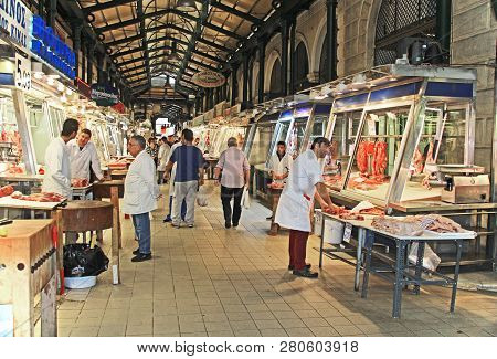 Athens, Attica, Greece - October 17, 2018:  Shoppers And Owners Along A Large Hall In The Huge  Cove