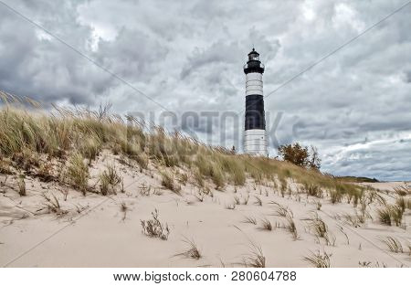 Lighthouse Beach Background. The Big Sable Lighthouse On The Coast Of Lake Michigan Surrounded By Du