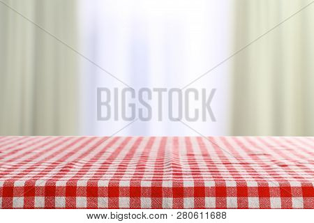 Empty Table In Room With Checkered Red Napkin On Blurred Background. Space For Design