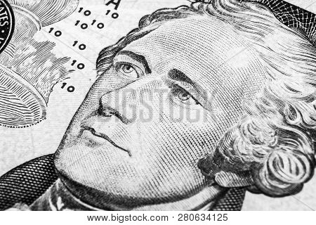 Close Up View Portrait Of Alexander Hamilton On The One Ten Dollar Bill. Background Of The Money. 10