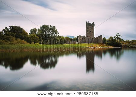 Ross Castle Ruins And The Lough Leane Lake Located In The Killarney National Park, Ireland. Long Exp