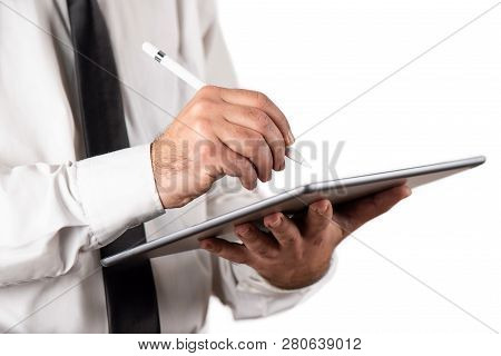Businessman Using His Digital Tablet Isolated On White Background