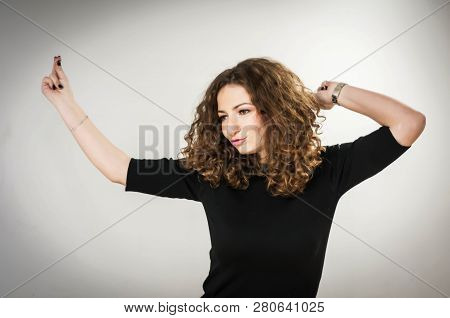 Young Beautiful Caucasian Girl Dancing. Photo Studio, Light Gray Background. Positive Energy, Great
