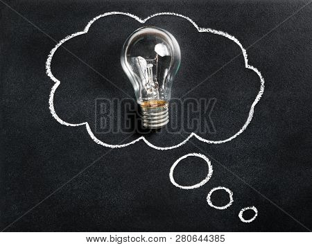 Light Bulb On Chalkboard. Thinking Of New Great Idea. Brainstorming And Creating. Creativity, Innova