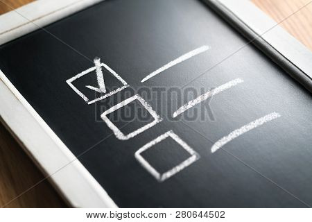 Checklist On Chalkboard. Agenda And Progress Of Project In Business. Document Of Finished Work Dutie