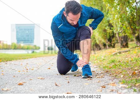 Athlete Running Outdoor And Suffering For Ankle Ligament Pain