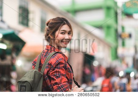 Traveler Backpacker Asian Woman Travel In Khao San Road At Bangkok, Thailand. Happy Young Female Spe