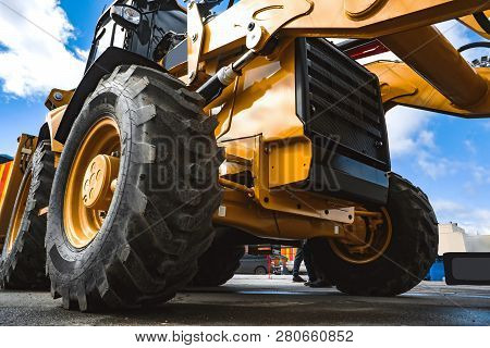 The Hydraulic Tractor Is Yellow. Crawler Bulldozer At The Exhibition