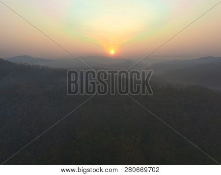Fantastic Dreamy Sunrise On Top Of Rocky Mountain With View Into Misty Valley.mountain View.foggy Mo