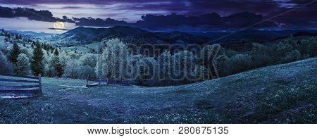 Panorama Of Mountainous Countryside In Springtime At Night In Full Moon Light. Beautiful Highland La