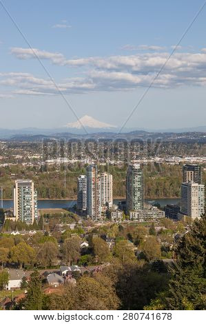 Portland, Oregon - April 14, 2014:  A Tram Car View Of City Buildings, The Willamette River, And A D